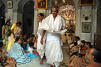 INDIA (West Bengal - Calcutta)  2006,On the ocassion of Durga Puja Festival  family  members in traditional bengali dresses at Dev family house. Devs are the most known fudal family during British Period. Durga Puja Festival is the biggest festival among bengalies.  As Calcutta is the capital of West Bengal and cultural hub of  the bengali community Durga puja is held with the maximum pomp and vigour. Ritualistic worship, food, drink, new clothes, visiting friends and relatives places and merryment is a part of it. In this festival the hindus worship a ten handed godess riding on a lion armed wth all possible deadly ancient weapons along with her 4 children (Ganesha - God for sucess, Saraswati - Goddess for arts and education, Laxmi - Goddess of wealth and prosperity, Kartikeya - The god of manly hood and beauty). Durga is symbolised as the women power in Indian Mythology.  In Calcutta people from all the religions enjoy these four days of festival in the moth of October. Now the religious festival has become the biggest cultural extravagenza of Calcutta the cultural capital of India. Artistry and craftsmanship can be seen in different sizes and shapes in form of the idol, the interior decor and as well as the pandals erected on the streets, roads and  parks.- Arindam Mukherjee