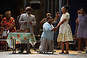 London, UK. 10.07.2012. Cape Town Opera returns to the London Coliseum with their acclaimed production of Porgy and Bess. Picture shows:  Holding hands - Nonhlanhla Yende (Bess) and Xolela Sixaba (Porgy). Photo credit: Jane Hobson