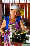 "Dona Mara making tortillas in her home in Chachagua, Costa Rica, Central America.  Dona invites people to her home to teach them how to make ""Tortillas con queso, (tortillas with cheese),"" by hand, cooked on a wood-burning stove.  This is a traditional Costa Rican dish served with or without sour cream."