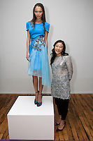 Fashion designer Yuna Yang, poses with a model, during her Yuna Yang Spring Summer 2012 Magic collection, during New York Fashion Spring 2012, on September 7, 2012.