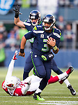 Seattle Seahawks quarterback Russell Wilson (3) scrambles against the Arizona Cardinals at CenturyLink Field in Seattle, Washington on November 23, 2014. Wilson rushed for 73 yards, completed 17 of 22 passes for 211 yards and one touchdown in the Seahawks 19-3 win over the Cardinals.    ©2014. Jim Bryant Photo. All Rights Reserved.