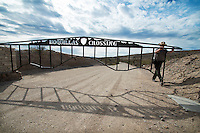 A park ranger closes the gate to the Boquillas Crossing in Big Bend National Park on December 21, 2012..Robert W. Hart/Special Contributor