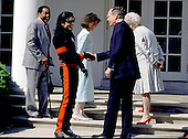 Michael Jackson and United States President George H.W. Bush shake hands and share a laugh after speaking to reporters in the Rose Garden at the White House in Washington, DC on April 5, 1990..Credit: Ron Sachs / CNP
