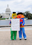 Bert and Ernie , Christina Fetzko and her friend Katie Ringersen of Landover MD. show their support for PBS and President Obama at the Million Muppet March on the National Mall in front of the Capital in Washington DC Saturday Nov. 3, 2012. Supporters of President Obama and PBS rally Saturday in  Washington DC just days before the Presidential Election.Photo ©Suzi Altman