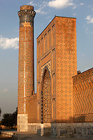 Low angle view of one of the 4 corner minarets,Bibi-Khanym Mosque, 15th century,  Samarkand, Uzbekistan, pictured on July 17, 2010, in the afternoon. Named after the wife of Amir Timur, 14th century ruler, the mosque was constructed following his 1399 Indian campaign. It collapsed after an earthquake in 1897 and was restored in the late 20th century. Samarkand, a city on the Silk Road, founded as Afrosiab in the 7th century BC, is a meeting point for the world's cultures. Its most important development was in the Timurid period, 14th to 15th centuries. Picture by Manuel Cohen.