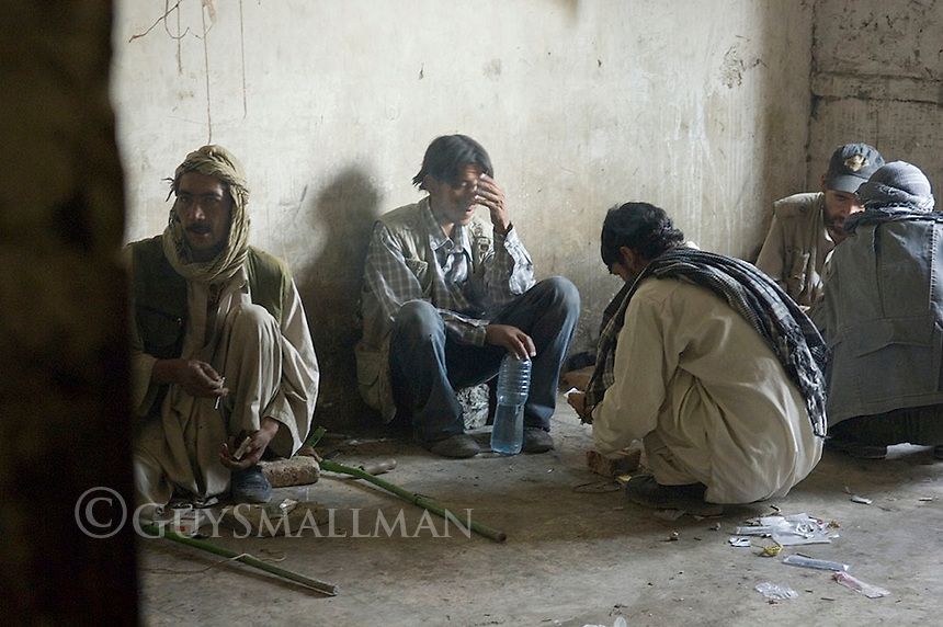 Russian Cultural Palace Kabul in use by heroin addicts. The building was destroyed by the Mujahadeen during the Afghan civil war. Hundreds of people were smoking and injecting Heroin within its walls.
