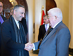 Father Michel Jalakh (left), general secretary of the Middle East Council of Churches,  greets Iraqi President Fuad Masum on January 22, 2017, during the visit of a high-level ecumenical delegation to Baghdad.