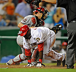 10 July 2008: Washington Nationals' shortstop Cristian Guzman slides home safely on an Austin Kearns triple to tie the game 5-5 in the bottom of the tenth inning against the Arizona Diamondbacks at Nationals Park in Washington, DC. The Diamondbacks defeated the Nationals 7-5 in 11 innings to take the rubber match of their 3-game series in the Nation's Capitol...Mandatory Photo Credit: Ed Wolfstein Photo