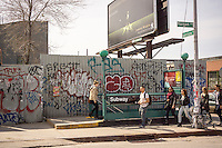 Morgan Avenue subway entrance in the Bushwick neighborhood of Brooklyn in New York on Saturday, April 19, 2014. The neighborhood is undergoing gentrification changing from a rough and tumble mix of Hispanic and industrial to a haven for hipsters, forcing many of the long-time residents out because of rising rents.. (©Richard B. Levine)