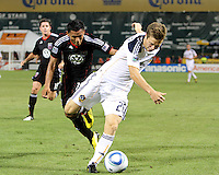 Andy Najar #14 of D.C. United battles for the ball with Michael Stephens #26 of the Los Angeles Galaxy during an MLS match at RFK Stadium on July 18 2010, in Washington D.C. Galaxy won 2-1.