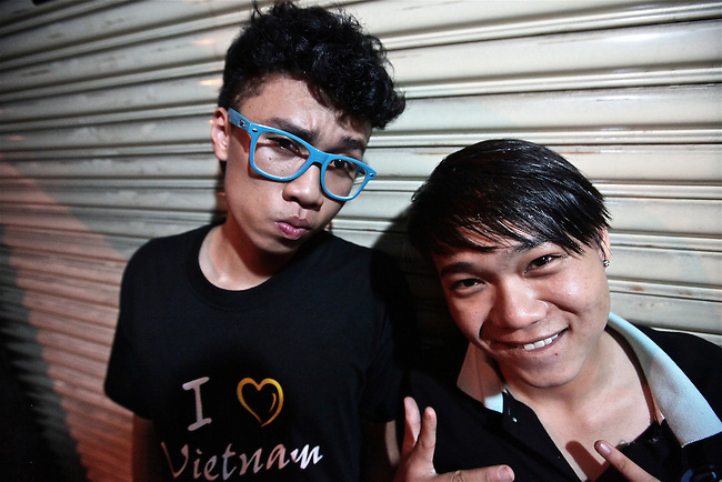Freestyle rappers MC-Jack and B-Boy Mix strike a pose one night on Bui Vien Street in Ho Chi Minh City, Vietnam. Aug. 18, 2011.