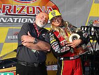 Feb 26, 2017; Chandler, AZ, USA; NHRA top fuel driver Leah Pritchett celebrates with team pr rep Jeff Wolf after winning the Arizona Nationals at Wild Horse Pass Motorsports Park. Mandatory Credit: Mark J. Rebilas-USA TODAY Sports