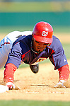 15 March 2006: Damian Jackson, infielder for the Washington Nationals, dives back safely to first during a Spring Training game against the New York Mets. The Mets defeated the Nationals 8-5 at Space Coast Stadium, in Viera, Florida...Mandatory Photo Credit: Ed Wolfstein..