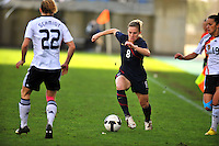 USA's Amy Rodriguez splits between two German defenders.  The USA captured the 2010 Algarve Cup title by defeating Germany 3-2, at Estadio Algarve on March 3, 2010.