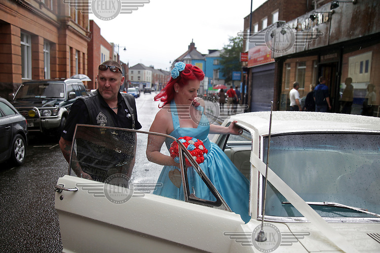 A biker/rocker couple get into their bridal car following their wedding at the town hall. <br /> The town of Boston had the country's highest proportion of 'leave' votes cast in the EU referendum with almost 76 percent of ballots cast for Brexit. Lincolnshire has, in recent years, seen an influx of EU workers drawn to the area's agricultural industry. The 2011 census found about 13 percent of Boston's residents were born in Eastern Europe and migrated to the UK since 2004.