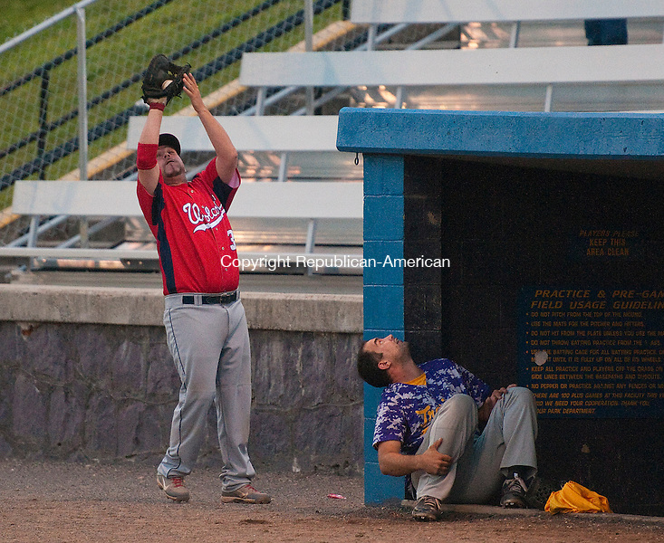 TORRINGTON, CT 082014JS14--Wolcott's Andy LaCapra (3) catches a pop-up near the dugout during game 1 of their Tri-State League finals against Tri-Town Wednesday at Fuessenich Park in Torrington. <br /> Jim Shannon Republican-American