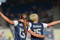 Glasgow, Scotland - July 25, 2012: Alex Morgan and Megan Rapinoe celebrate Morgan's first of two goals at today's game vs France in Glasgow, Scotland in the opening game for the USA at the 2012 London Olympics.