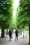Friends walking in Tuileries Gardens (Jardin des Tuileries) in spring, Paris, France, Europe