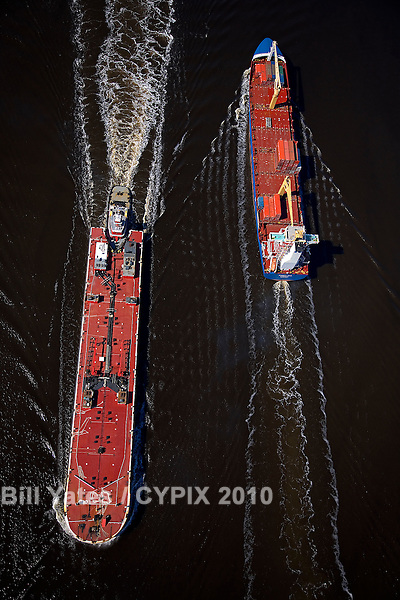Cargo ship and fuel barge passing in the St. Johns River Channel JaxPort helicopter aerial