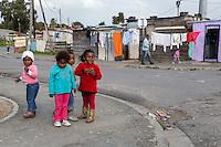 South Africa, Cape Town, Guguletu Township.  Four Little Girls.