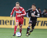 Andy Najar #14 of D.C. United  runs up behind Justin Mapp #21 of the Chicago Fire during an MLS match on April 17 2010, at RFK Stadium in Washington D.C. Fire won the match 2-0.