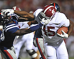 Alabama running back Jalston Fowler (45) stiff arms Ole Miss' Senquez Golson (21) on his way to scoring a touchdown at Vaught-Hemingway Stadium in Oxford, Miss. on Saturday, October 14, 2011. Alabama won 52-7.