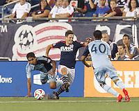 Foxborough, Massachusetts - September 3, 2014: First half action. In a Major League Soccer (MLS) match, the New England Revolution (blue/white) vs Sporting Kansas City (light blue), 1-1 (halftime), at Gillette Stadium.