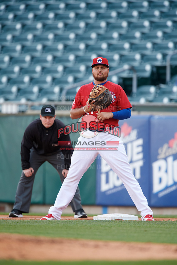 Buffalo Bisons first baseman Rowdy Tellez (21) and first base umpire Sean Barber during a game against the Syracuse Chiefs on May 18, 2017 at Coca-Cola Field in Buffalo, New York.  Buffalo defeated Syracuse 4-3.  (Mike Janes/Four Seam Images)