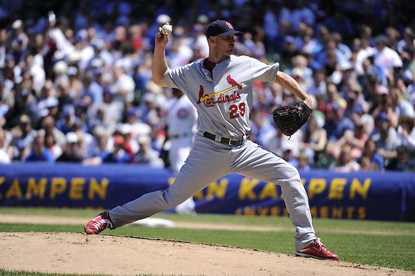 CHICAGO - MAY  28:  Chris Carpenter #29 of the St. Louis Cardinals pitches against the Chicago Cubs on May 28, 2010 at Wrigley Field in Chicago, Illinois.  The Cardinals defeated the Cubs 7-1.  (Photo by Ron Vesely)