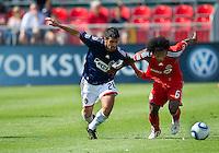 07 August 2010: Chivas USA midfielder Paulo Nagamura #26 and Toronto FC midfielder Julian de Guzman #6 in action during a game between Chivas USA and Toronto FC at BMO Field in Toronto..Toronto FC won 2-1.