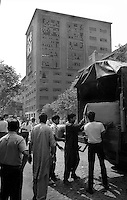 Roma  Luglio 1990.Ex Pastificio Pantanella occupato da centinaia di immigrati asiatici provenienti dal Pakistan e Bangladesh..Gli aiuti della Protezione Civile..Rome July 1990.Ex Pastificio Pantanella occupied by hundreds of Asian immigrants from Pakistan and Bangladesh..Aid of the Civil Protection