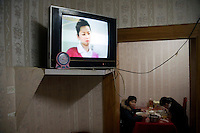 Inside a Han Chinese restaurant in Urumqi, Xinjiang, China. The city is divided between Han and Uighur ethnic groups and in 2009 saw violent clashes between the groups.