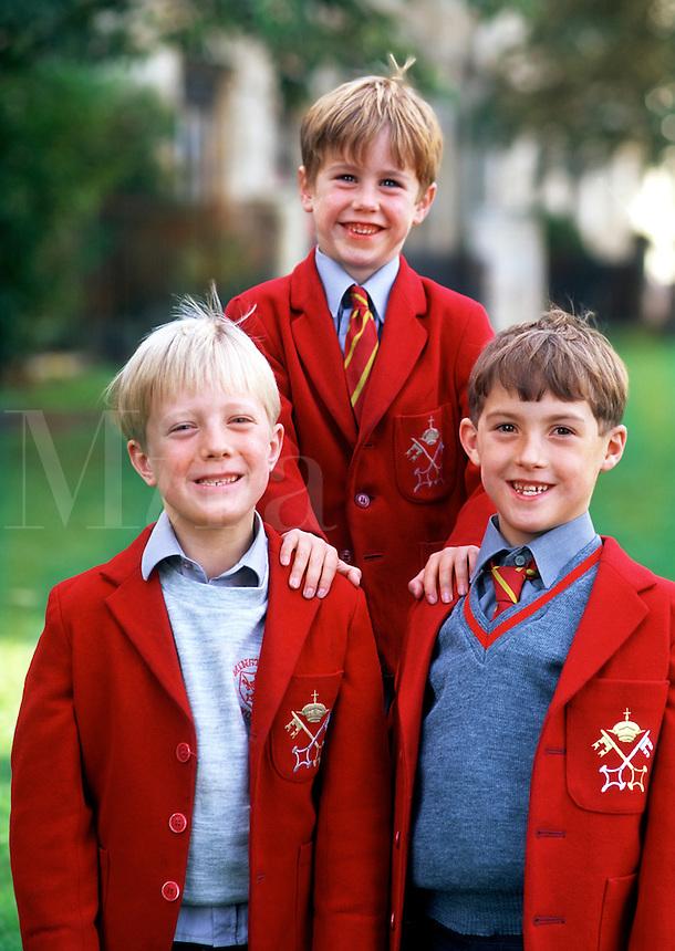 Portrait of smiling, young British Public School boys in traditional uniform attire. York, England.