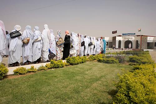 Darfurian women line-up at Al Fashir airport, Sudan to greet British ...