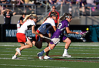 Sarah Mollison (1) and Brandi Jones (4) of Maryland chase down Jessica Russo (23) of Northwestern during the NCAA Championship held in Johnny Unitas Stadium at Towson University in Towson, MD.  Maryland defeated Northwestern, 13-11, to win the title.