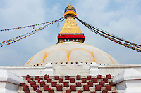 The White Stupa at Boudhanath in Nepal. Boudhanath is one of the holiest Buddhist sites in Kathmandu, Nepal. The Buddhist stupa of Boudhanath dominates the skyline. The ancient Stupa is one of the largest in the world. The Stupa is on the ancient trade route from Tibet which enters the Kathmandu Valley. Tibetan merchants have rested and offered prayers here for many centuries. When refugees entered Nepal from Tibet in the 1950s, many decided to live around Boudhanath. The Stupa is said to entomb the remains of Kassapa Buddha.
