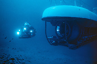 Aquarius Habitat with Deep Worker Submersible - Florida Keys. Aquarius is an underwater ocean laboratory located in the Florida Keys National Marine Sanctuary. The laboratory is deployed three and half miles offshore, at a depth of 60 feet, next to spectacular coral reefs. Scientists live in Aquarius during ten-day missions using saturation diving to study and explore our coastal ocean. Aquarius is owned by NOAA and is operated by the NOAA Undersea Research Program's (NURP) Undersea Research Center at the University of North Carolina Wilmington.
