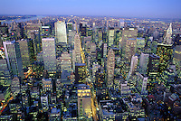 USA, New York, New York City. View of Manhattan skyline at dusk from the Empire State Building