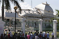 Haitians stand near the destroyed National Palace in Port au Prince, Haiti, Jan. 26, 2010. (Australfoto/Douglas Engle)