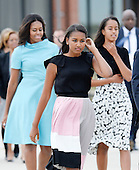 First Lady Michelle Obama with daughters Sasha and Malia arrive to welcome His Holiness Pope Francis on his arrival at Joint Base Andrews in Maryland on September 22, 2015. The Pope is making his first trip to the United States on a three-city, five-day tour that will include Washington, D.C., New York City and Philadelphia. <br /> Credit: Olivier Douliery / Pool via CNP