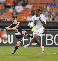 Taylor Kemp (33) of D.C. United goes against Andrew Farrell (2) of the New England Revolution. The New England Revolution defeated D.C. Untied 2-1, at RFK Stadium, Saturday July 27 , 2013.