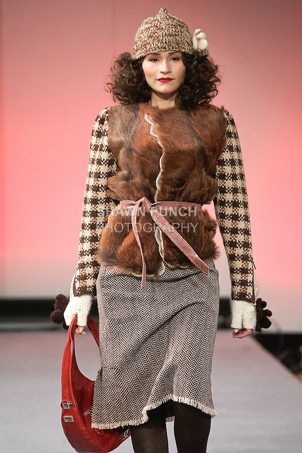 Model walks runway in an outfit from the Janerations Fall 2012 collection, by Janina Stankiene, during Couture Fashion Week New York Fall 2012.