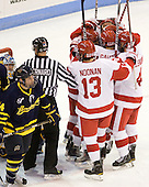The Terriers celebrate Ross Gaudet's (BU - 22) goal. - The visiting Merrimack College Warriors tied the Boston University Terriers 1-1 on Friday, November 12, 2010, at Agganis Arena in Boston, Massachusetts.
