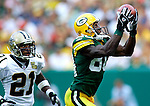 Green Bay's Donald Driver hauls in a 22-yard Brett Favre pass in front of New Orleans Jason Craft in the 3rd quarter. .The Green Bay Packers hosted the New Orleans Saints at Lambeau Field Sunday September 17, 2006. Steve Apps-State Journal.