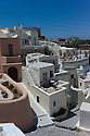 Santorini, Greece. 06.05.2014. View of the Heliophos boutique hotel in the whitewashed, mediaeval, village of Finikia. The homes in this village have been constructed in the hyposcafa manner i.e. the lower portions are dug out from the ground. Photogaph © Jane Hobson.