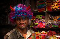 Vendor selling the powder for the Holi festival in Bikaner Rajasthan India