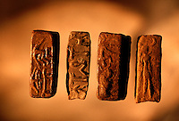 Early seals from Harappa. 4,800 years ago, at the same time as the early civilizations of Mesopotamia and Egypt, great cities arose along the flood plains of the Indus and Saraswati (Ghaggar-Hakra) rivers.  Developments at Harappa have pushed the dates back 200 years for this civilization, proving once and for all, that this civilization was not just an offshoot of Mesopotamia..They were a highly organized and very successful civilization.  They built some of the world's first planned cities, created one of the world's first written languages and thrived in an area twice as large as Egypt or Mesopotamia for 900 years (1500 settlements spread over 280,000 square miles on the subcontinent)..There are three major communities--Harappa, Mohenjo Daro, and Dholavira. The town of Harappa flourished during this period because of it's location at the convergence of several trade routes that spanned a 1040 KM swath from the northern mountains to the coast.