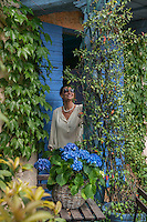 Michela Goldschmied stands in the blue-painted porch of her country home in Asolo