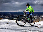 (Holyoke, MA, 01/29/17) Tim Mahoney of Holyoke, Mass., pedals over a frozen layer of snow with a set of studded mountain bike tires while riding atop Mount Tom on Sunday, January 29, 2017. Photo by Christopher Evans