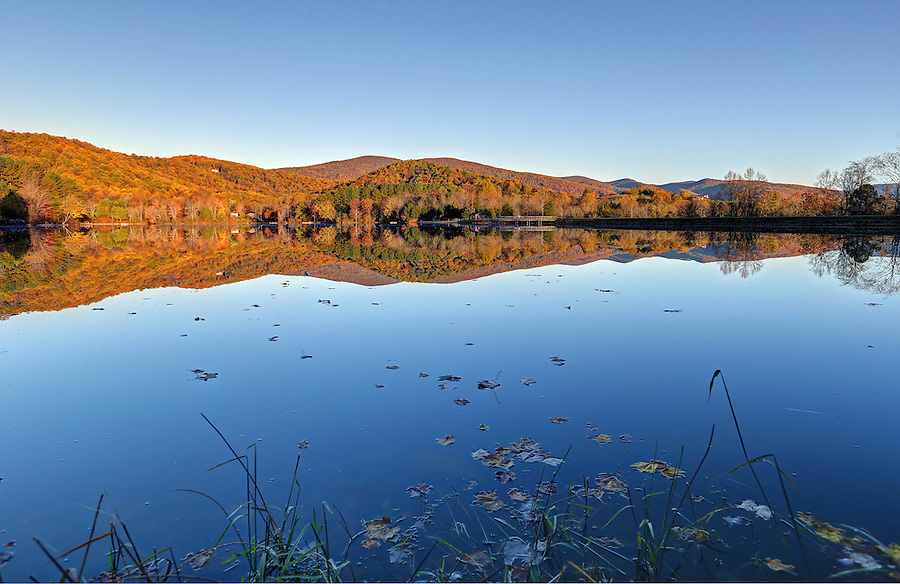 Sunrise at secret morning mountain lake reflecting the Blue Ridge Mountains in Greene County, Va. Photo/Andrew Shurtleff